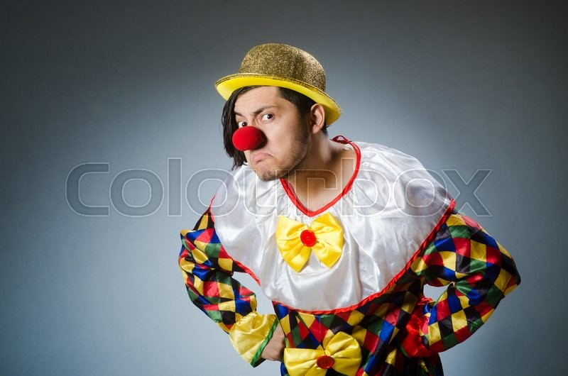 Stock image of 'Funny clown against dark background'