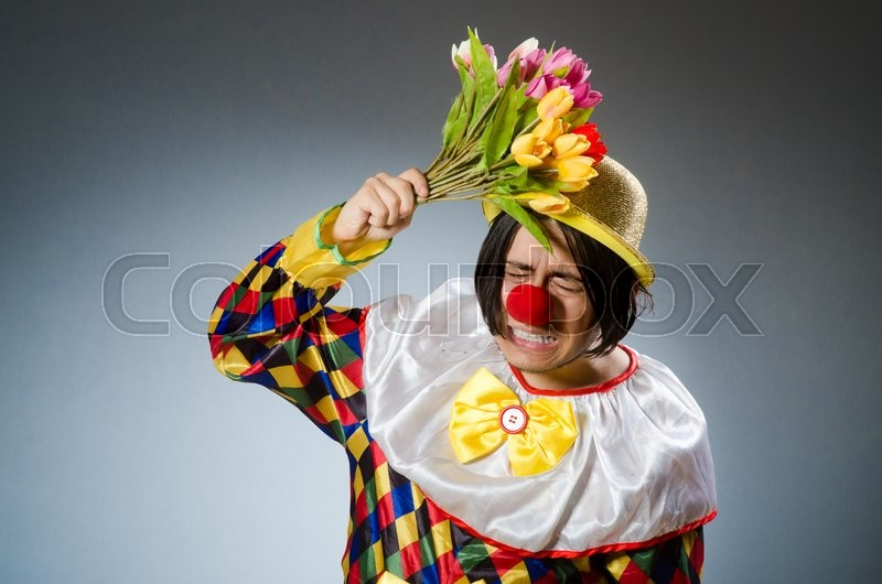 Stock image of 'Clown with tulip flowers in funny concept'