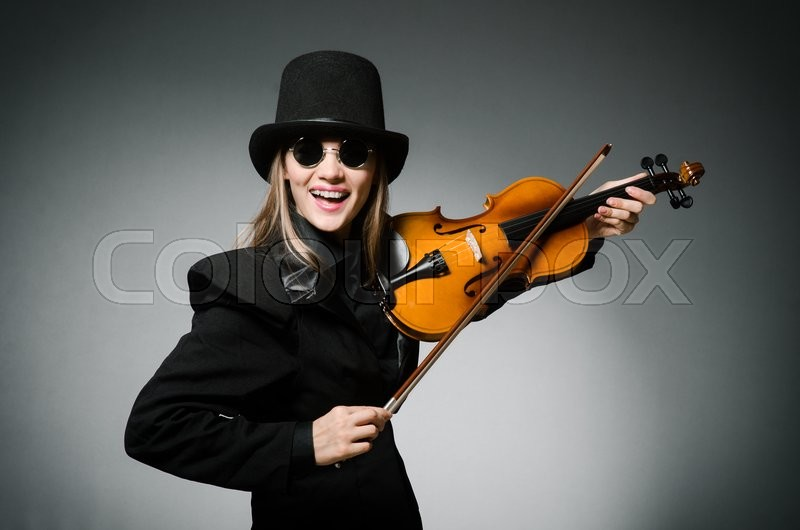 Stock image of 'Woman playing classical violin in music concept'