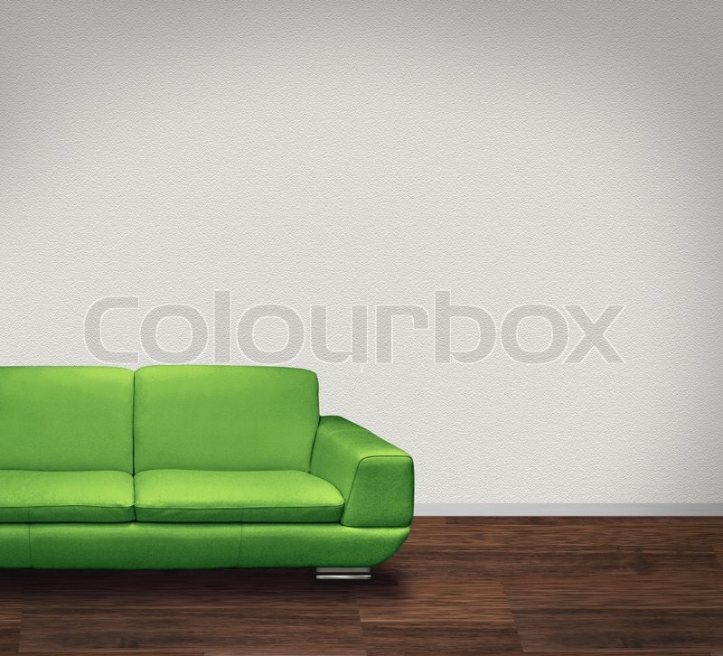 Modern Green Leather Sofa In Room With Dark Floor And White Walls