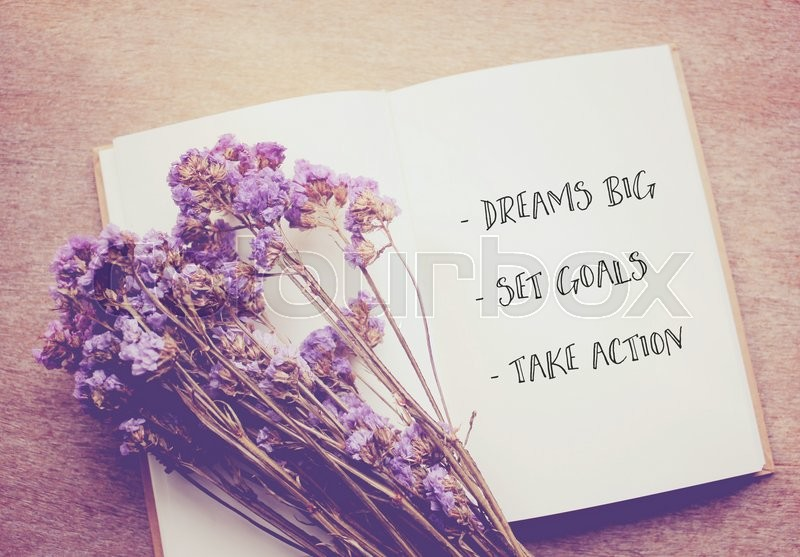 inspirational quote on notebook and dried statice flowers with