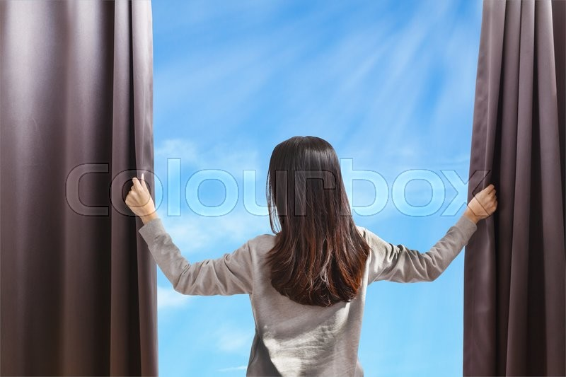 Asian portrait beautiful woman opening curtains on cloud sky background, stock photo