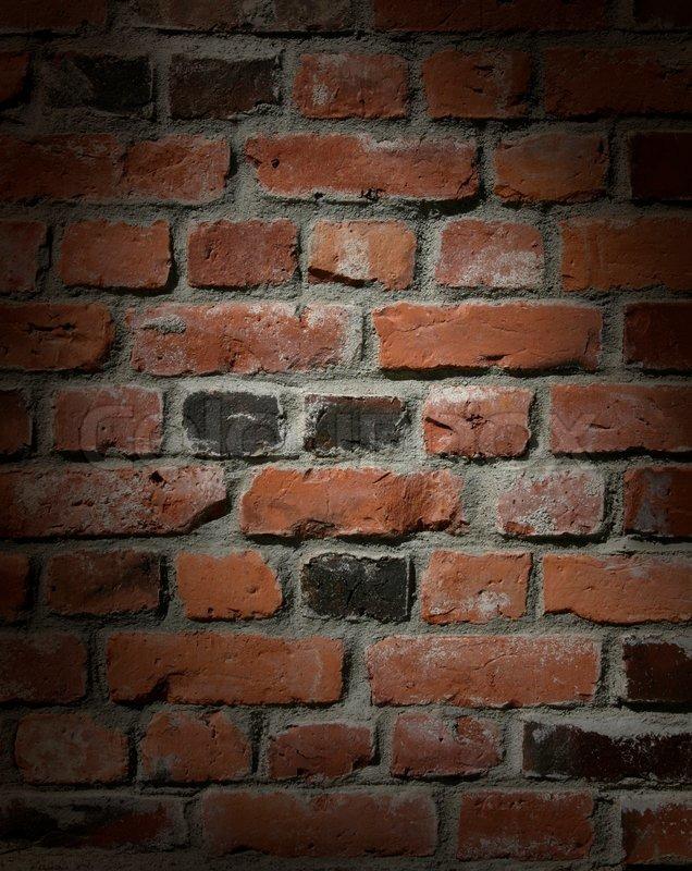 Dark brick wall with dramatic spot lighting  Stock Photo  Colourbox
