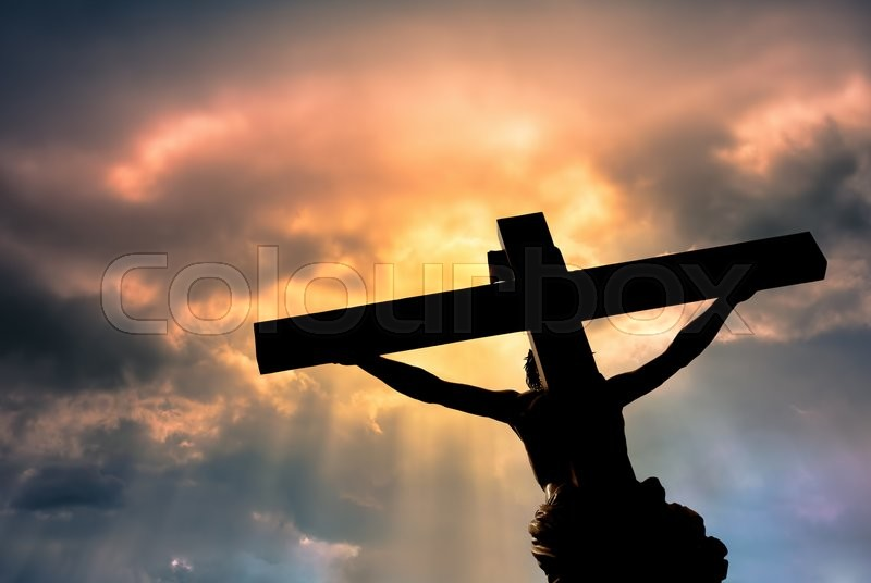 Jesus Christ Son of God over dramatic sky background religion and spirituality concept, stock photo