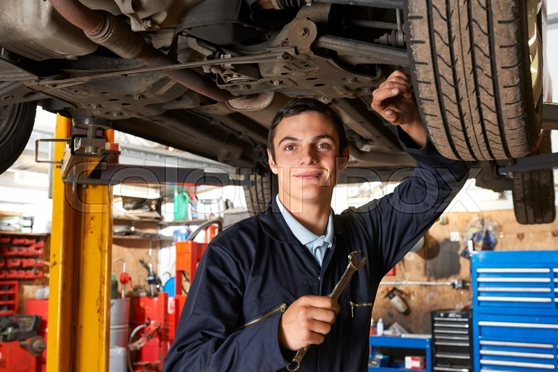 Apprentice Mechanic Working On Car Stock Photo Colourbox