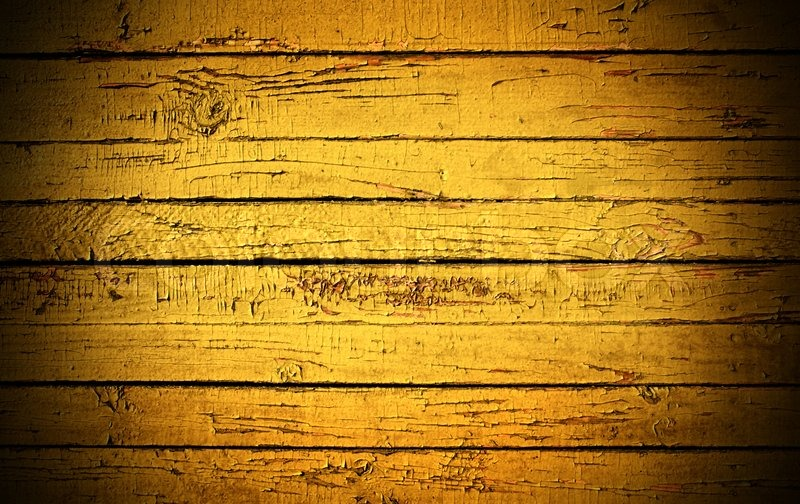 Grunge background from weathered yellow wooden plank ...