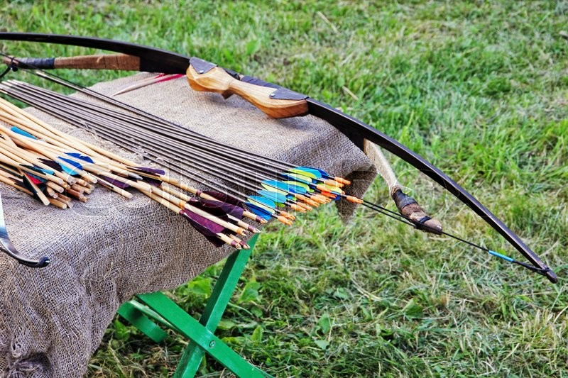 Bow and arrows on small table taken closeup, stock photo
