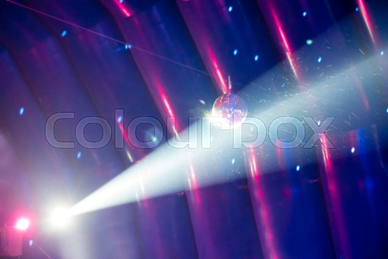 Disco ball and blue light ray on the stage, stock photo