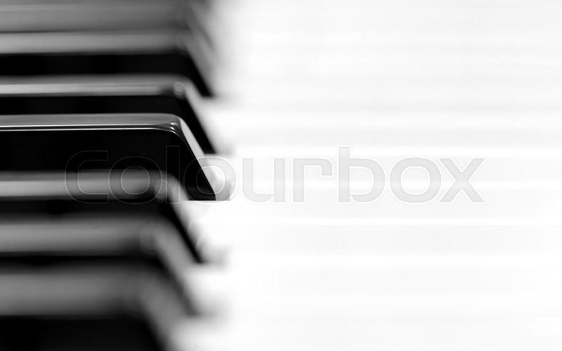 Close-up of piano keyboard. Close frontal view, stock photo