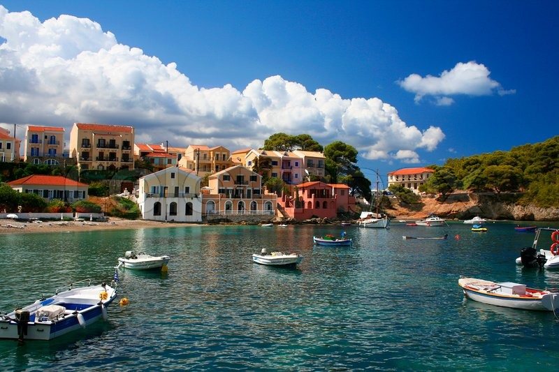 Greek sea shore village with fishing boats on turquoise for Ocean isles fishing village