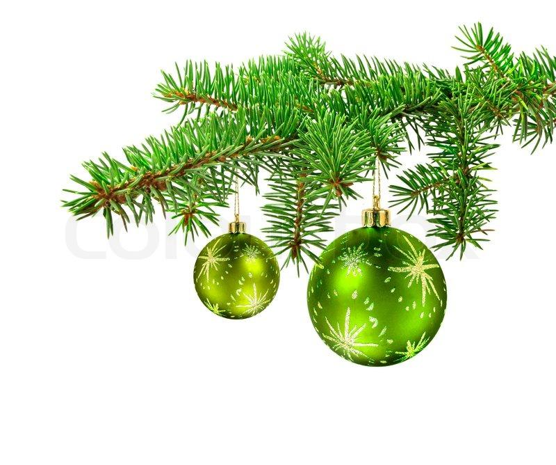 Green Kugeln hängen an einem Weihnachtsbaum Zweig , isoliert ...