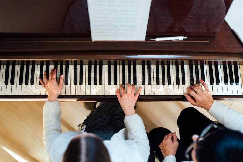 Piano lesson at a music school, top view, stock photo