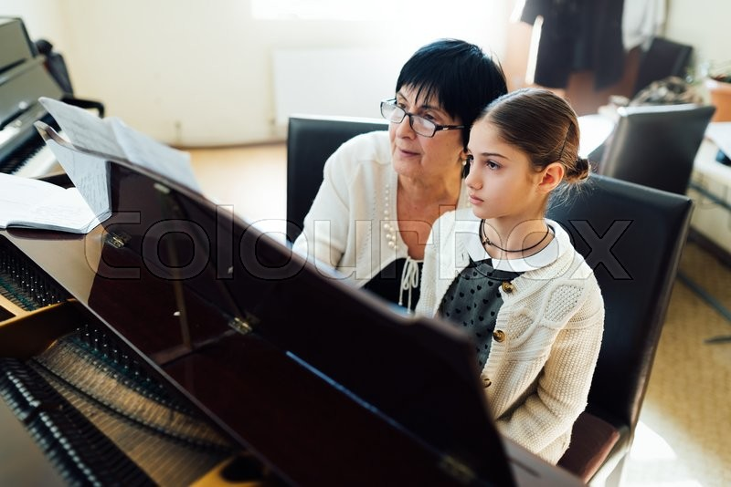 Piano lessons at a music school, stock photo