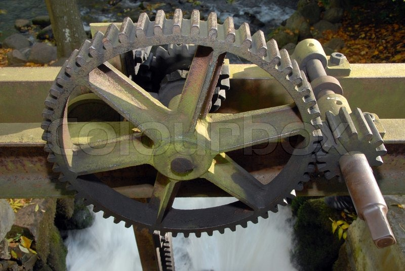 Old Engine Gears : Old steam engine with inactive rusty steely gears stock