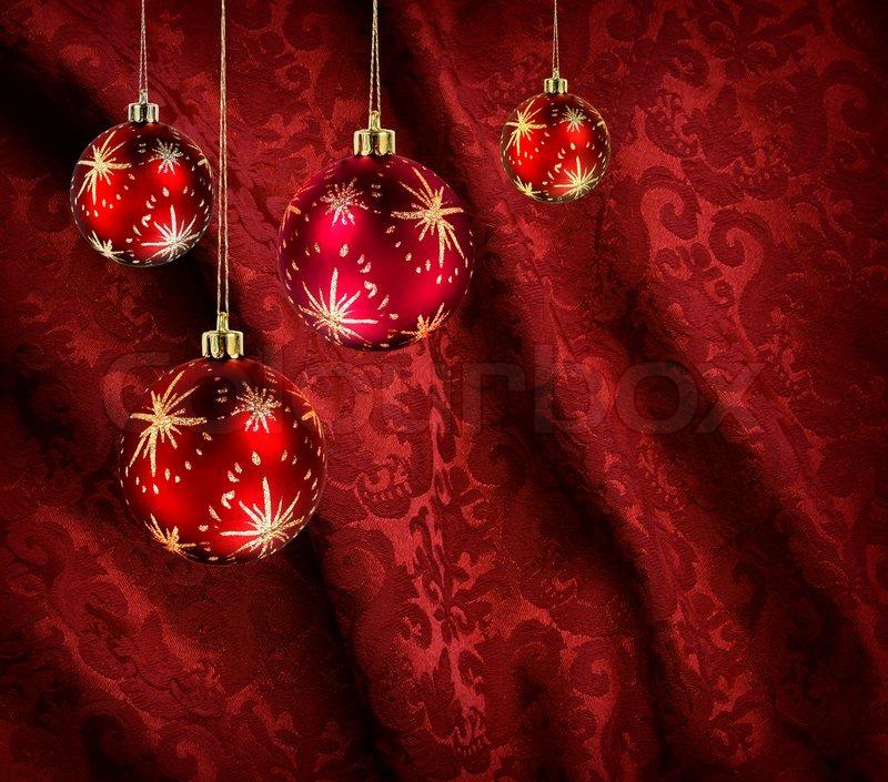Red Christmas Balls On Red Velvet Background Stock Photo
