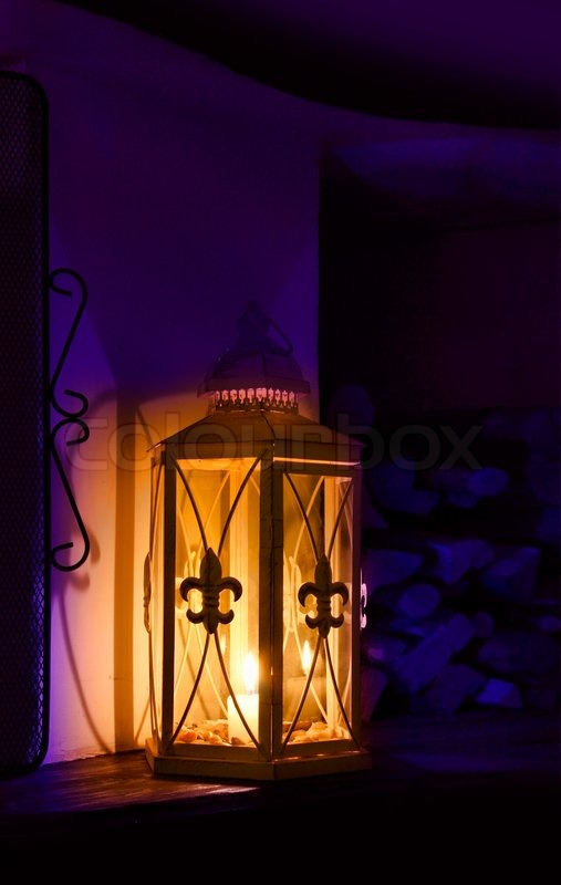 Romantic candle lantern with french lily ornaments decoration stock