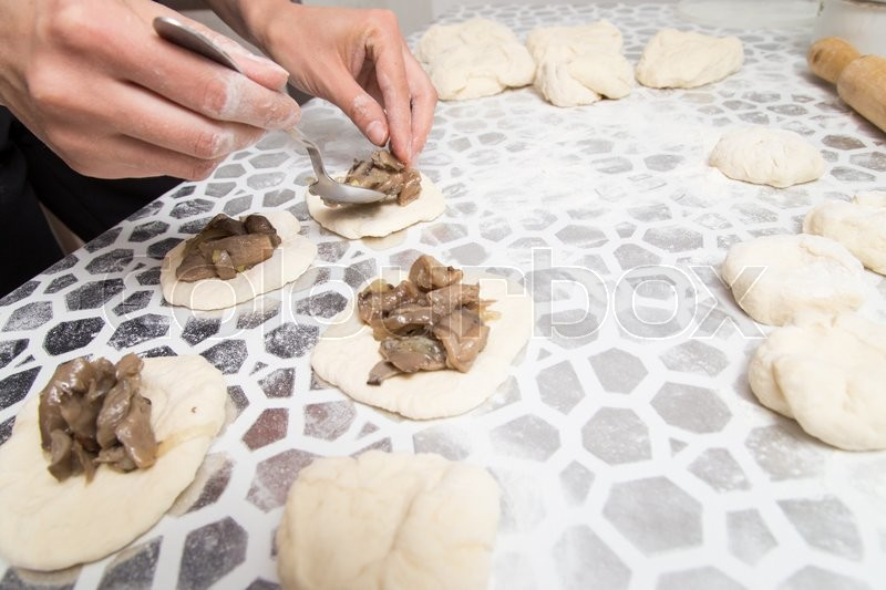 Cooking cakes of the dough in the kitchen, stock photo