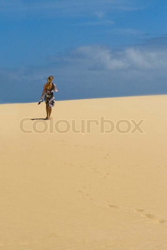 girl walking alone naked in desert