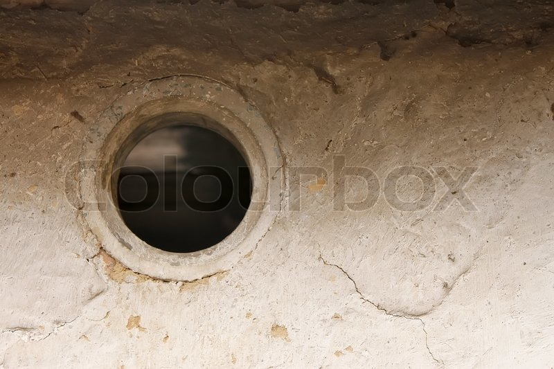 Ventilation hole in the wall of the old barn, stock photo