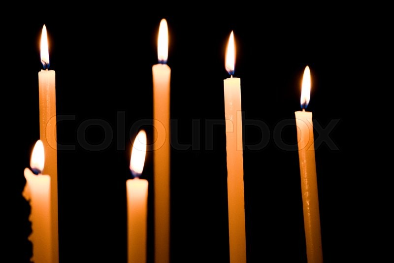 & Lighting candles in a church | Stock Photo | Colourbox