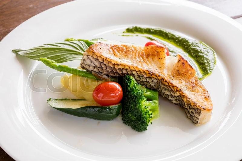 black cod fish fillet steak served with cucumber spinach