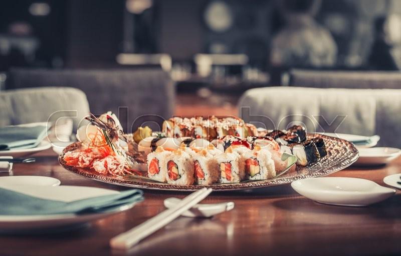 Japanese seafood sushi many tasty fresh Japanese sushi with tuna, caviar and shrimps, stock photo