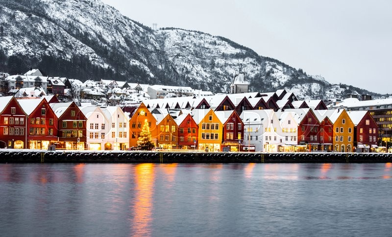 Bryggen street with wooden colored houses in Bergen at ...