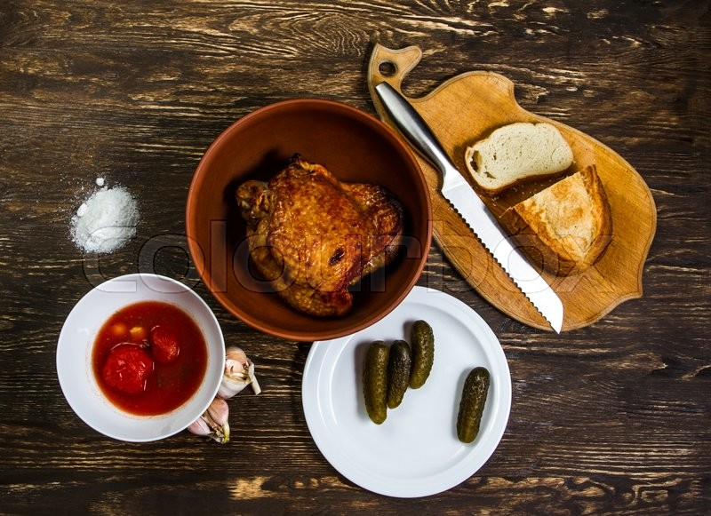 Tasty turkey meat looks good with honest, tomatoes, cucumbers and freshly baked bread, stock photo