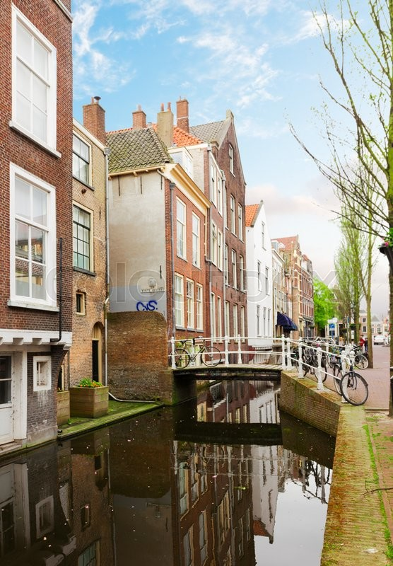 Street And Water Canal In Old Town Of Delft In Spring Time Holland Stock Photo Colourbox