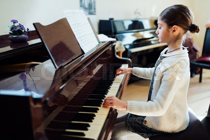 Beautiful schoolgirl playing piano at ... | Stock Photo ... - photo#6