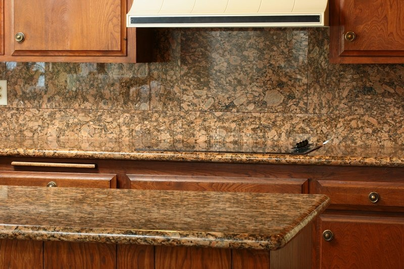 Granite Covered Countertops : Granite covering for a working surface and an electric plate, a ...