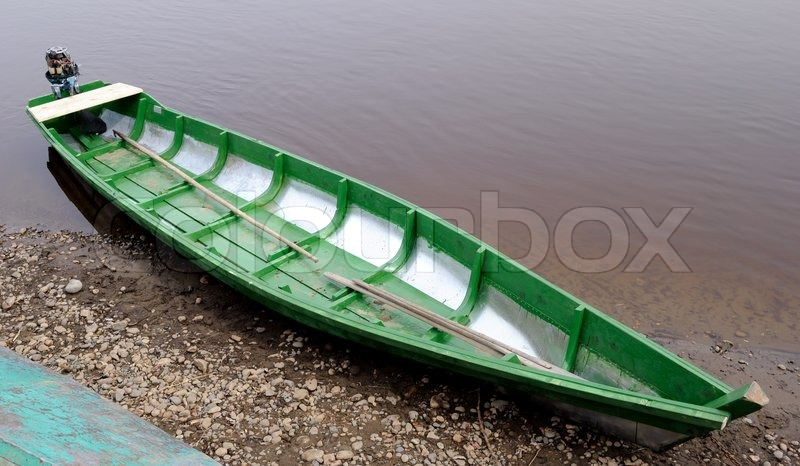 Homemade wooden boat with an outboard motor | Stock Photo ...