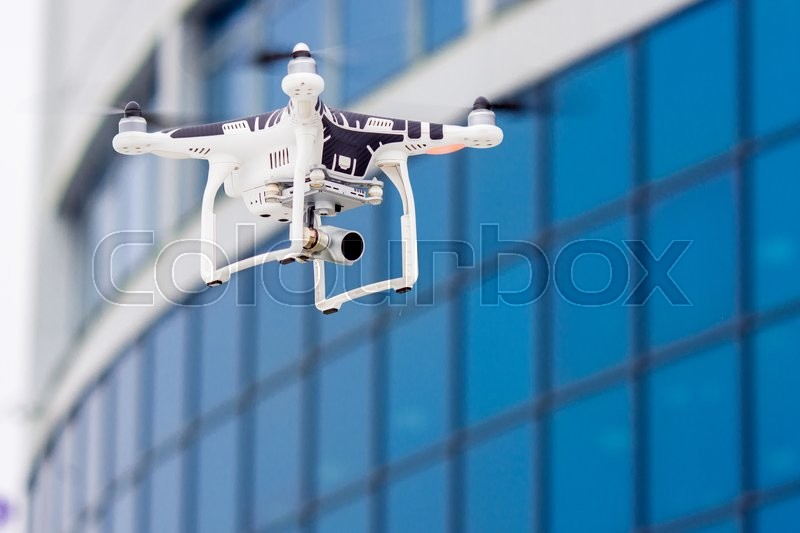 Hovering drone that takes pictures of city sights, stock photo