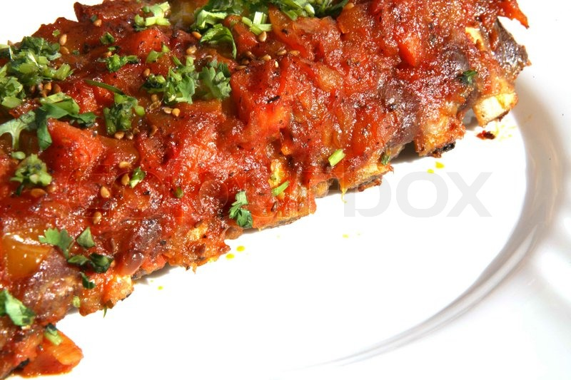 Stock image of 'Rack of ribs with BBQ sauce'