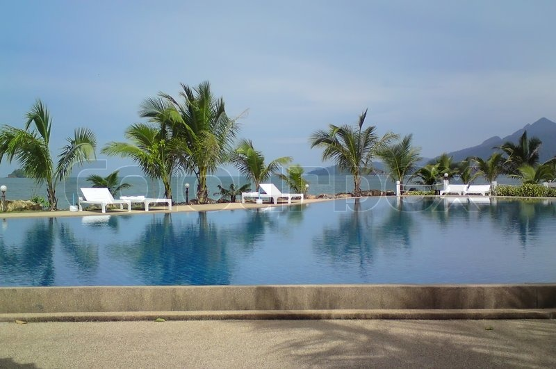 Tropical Swimming Pool Near The Beach Stock Photo