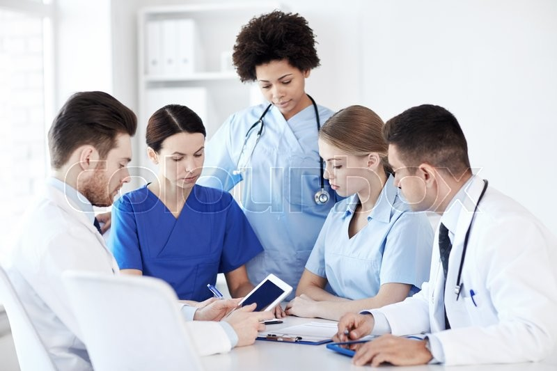 Hospital, profession, people and medicine concept - group of doctors with tablet pc computers meeting at medical office, stock photo