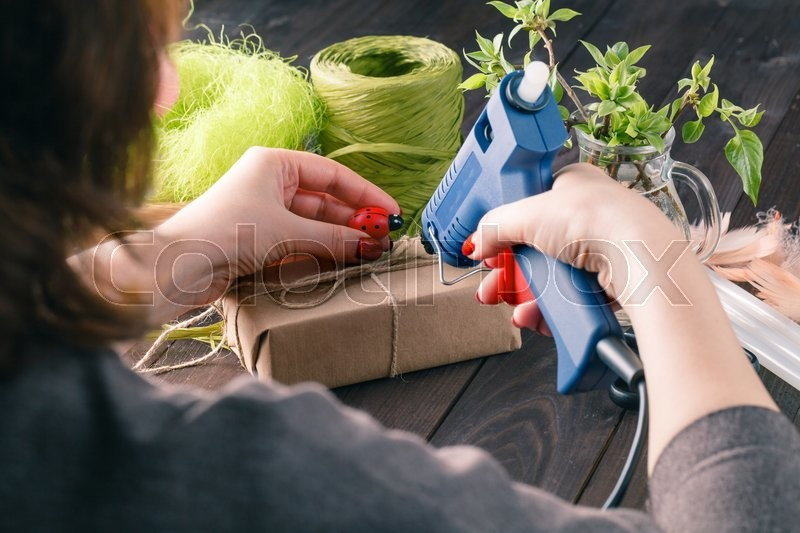 Overhead View Of Woman Making giftbox At Home, stock photo