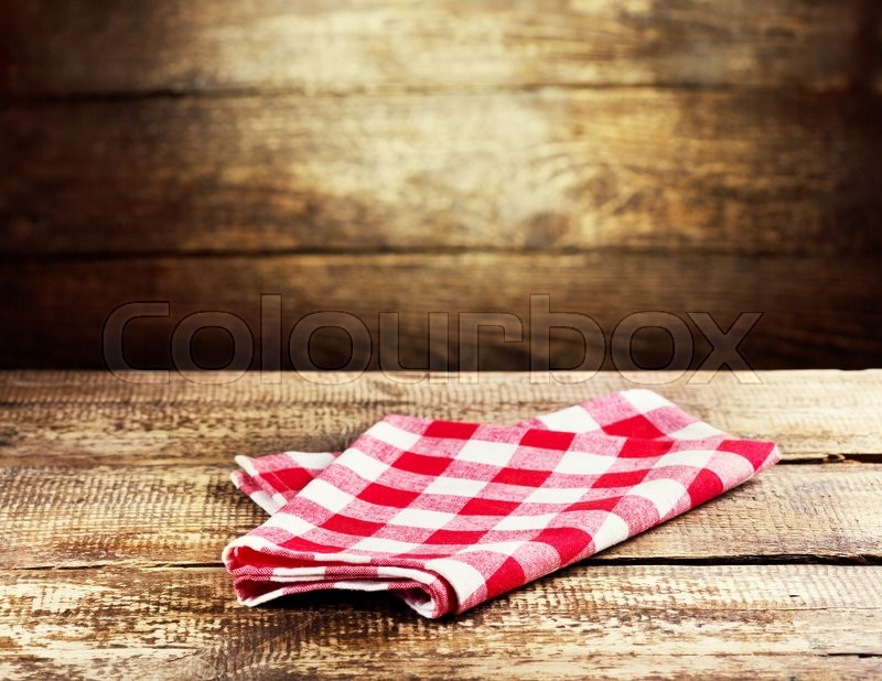 red tablecloth over rustic wooden background, stock photo