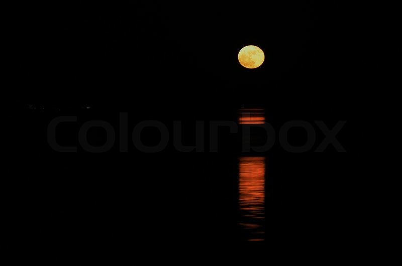 The moons light reflectiong in water, stock photo
