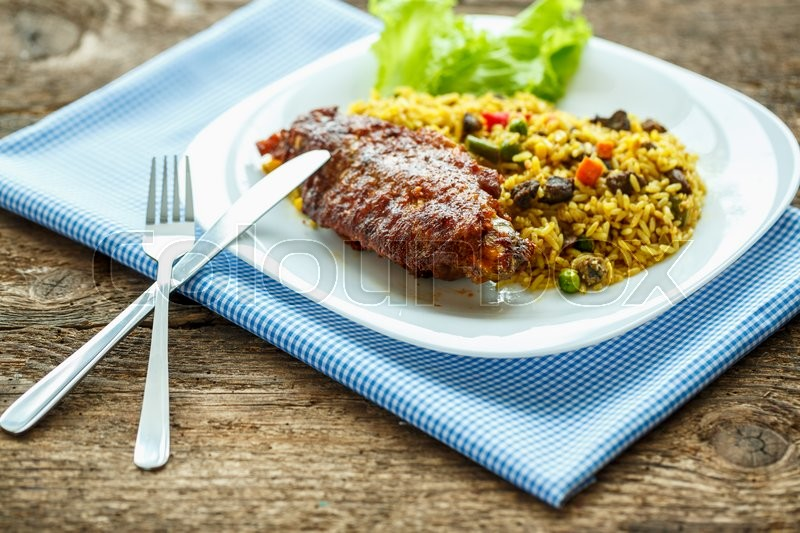 Delicious dish of turkey meat with rice and lettuce, stock photo