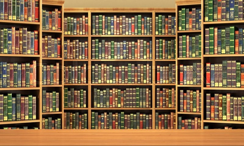 Table on background of bookshelf full of books . Old library, stock photo