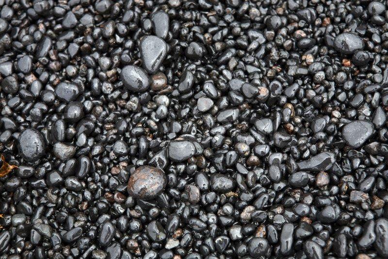 Wet sea pebbles on a beach close up, stock photo