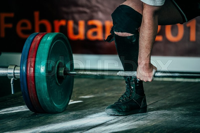 Closeup of a male athlete deadlift in competition in powerlifting, stock photo
