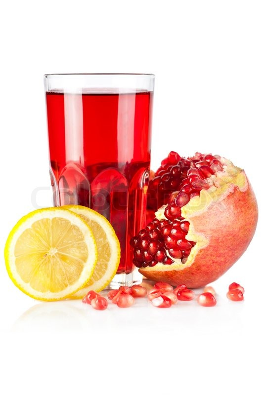 Fresh ripe pomegranate, lemon and glass of juice on white background ...