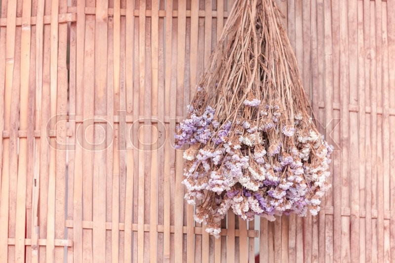 Bouquet of dried flowers hanging on bamboo background, stock photo, stock photo