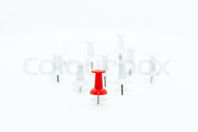 red push pin in front and white push pins at back leadership