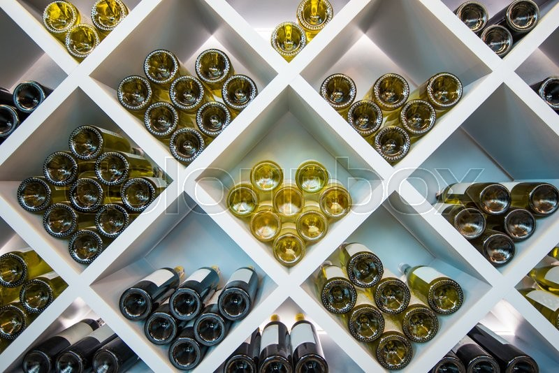 Wines White Wooden Shelve in Wines Cellar. Wines Selection, stock photo