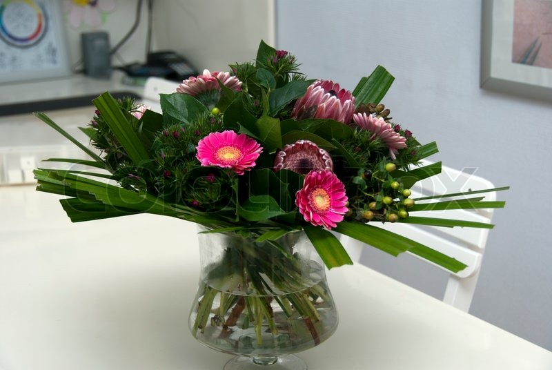 Vase with flowers on desk, stock photo