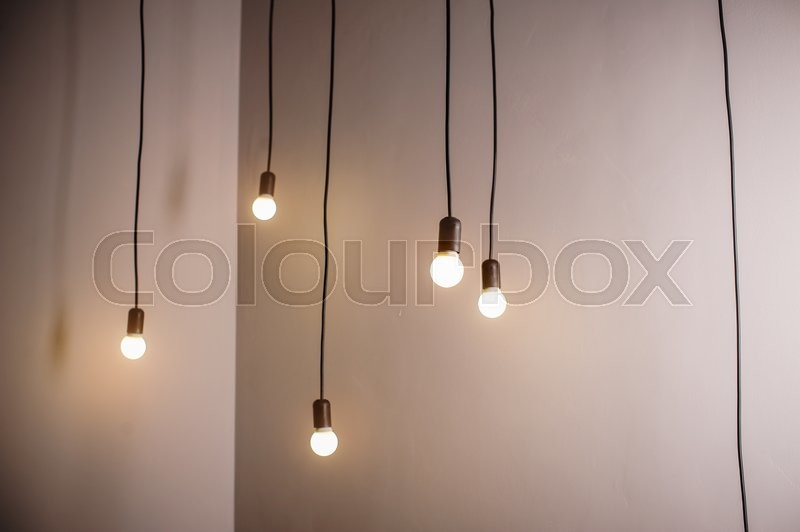 Many lamps on a long cord and hanging light in the room, stock photo