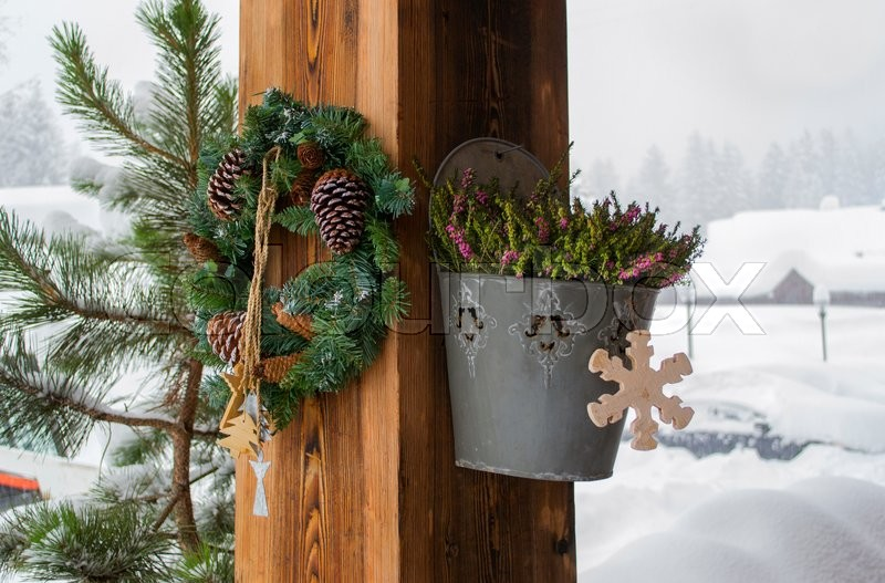 the rural house with christmas decorations on a wooden column stock photo colourbox